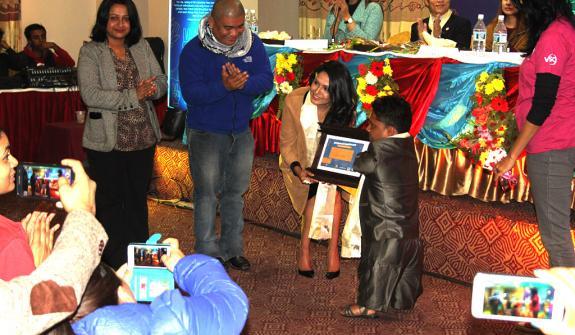 Indira Joshi awarding Nanda Raj Bhatta from Dhangadhi.